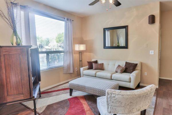 Bright living room at Laguna at Arrowhead Ranch in Glendale, Arizona
