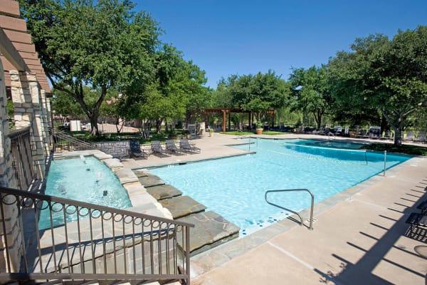 Outdoor swimming pool at Villas of Preston Creek in Plano, Texas