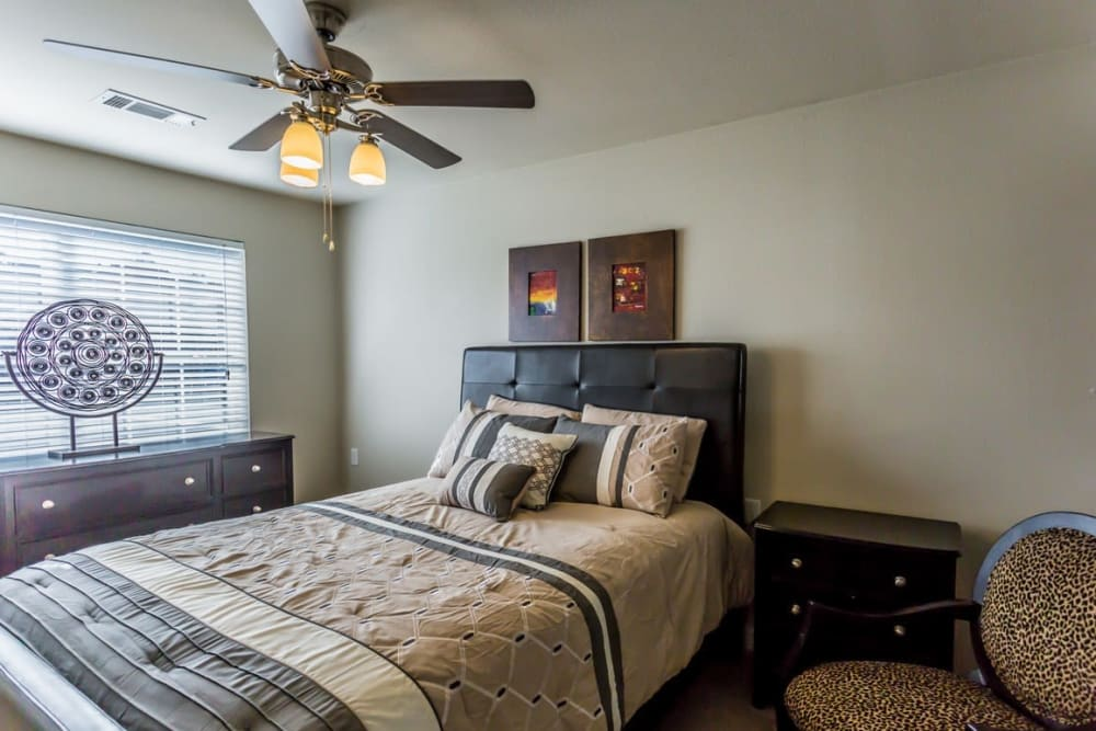 Bedroom with a ceiling fan at River Pointe in North Little Rock, Arkansas.