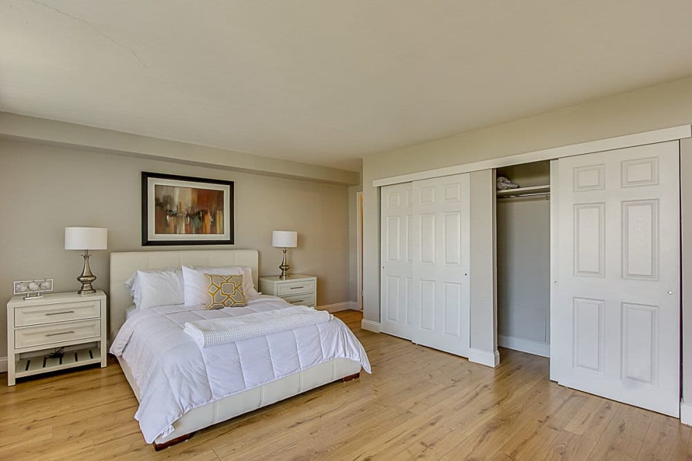 Master bedroom with wood style flooring at Chestnut Hill Tower in Philadelphia, Pennsylvania