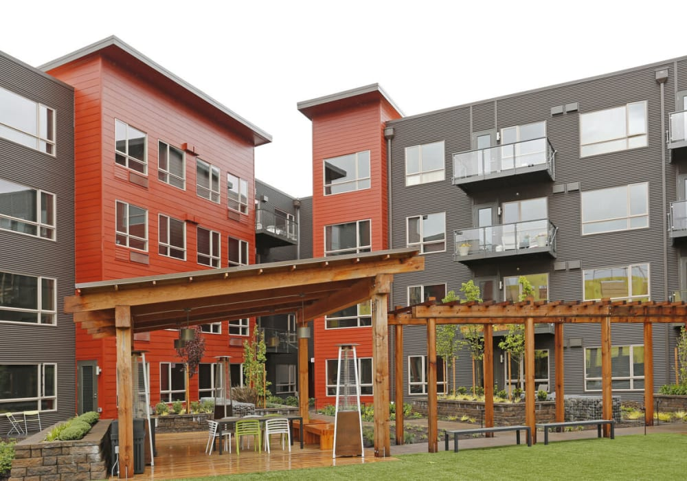 Beautiful courtyard with outdoor heaters at South Block Apartments in Salem, Oregon
