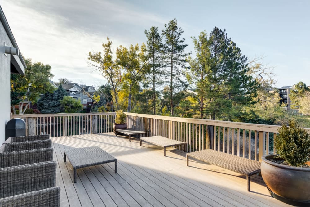 Tranquil seating area with ample seating and lake front views at Ashford Belmar in Lakewood, Colorado