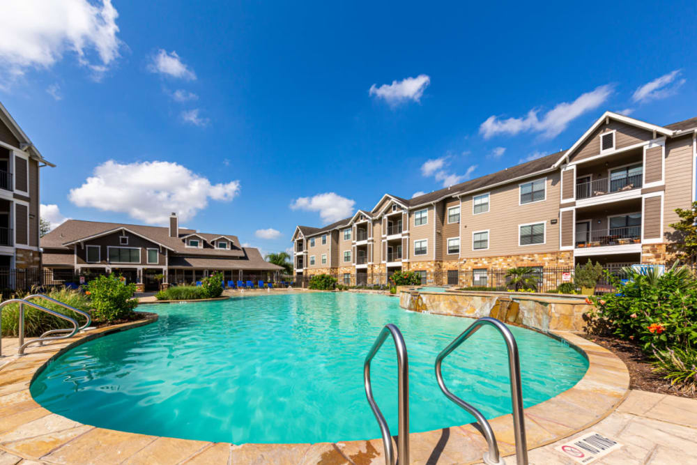 Resort-style, sparkling swimming pool at Marquis at Katy in Katy, Texas