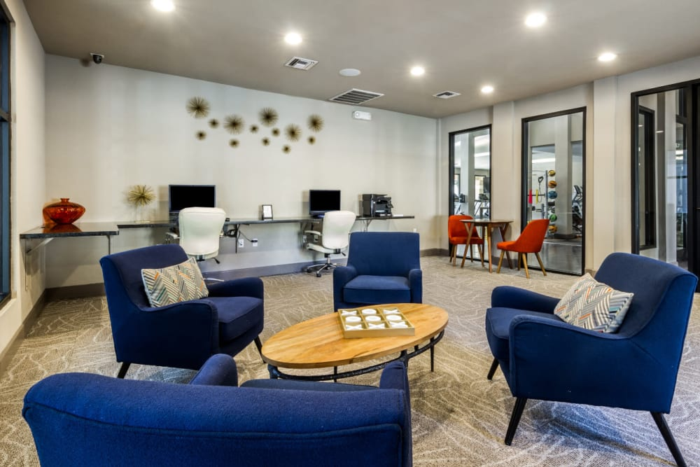 Business center with seating area in community lounge at Marquis at Barton Trails in Austin, Texas