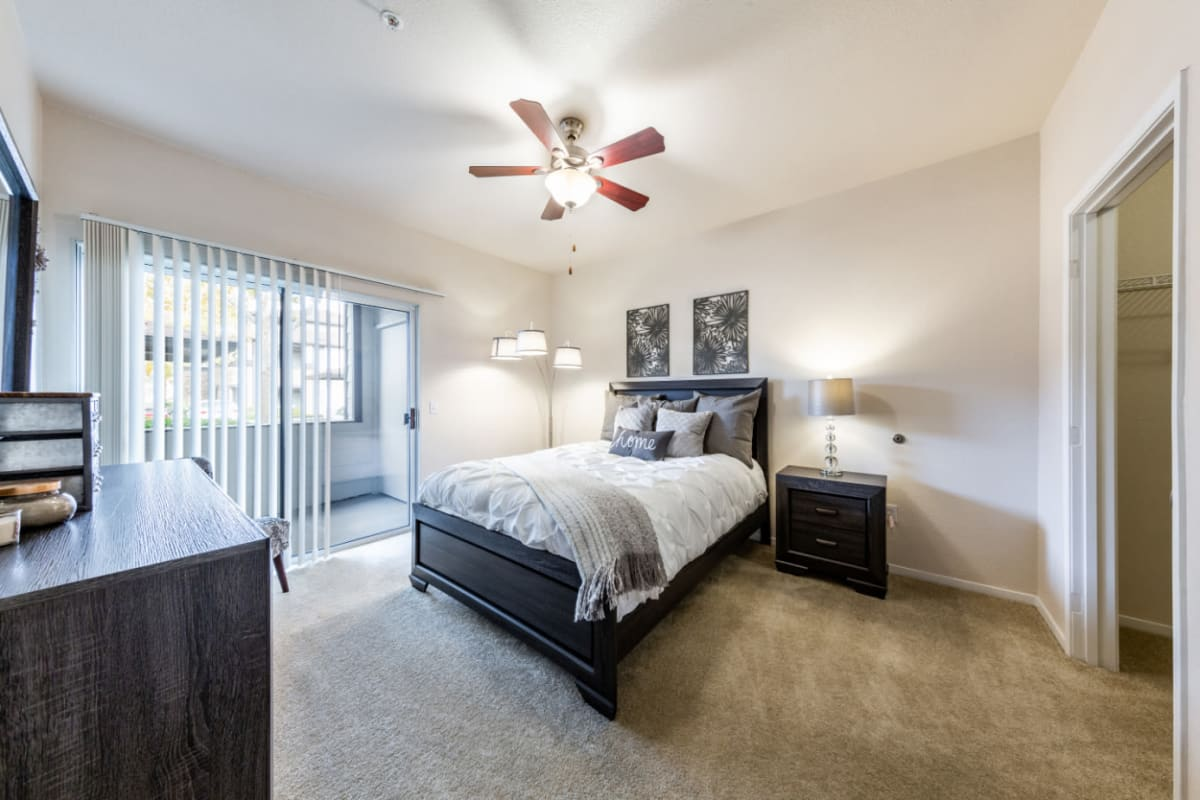 Spacious bedroom with private patio at The Fairmont at Willow Creek in Folsom, California