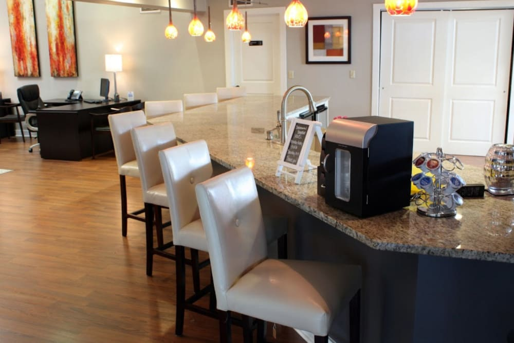 A resident clubhouse with bar seating at Goldelm at Metropolitan in Knoxville, Tennessee