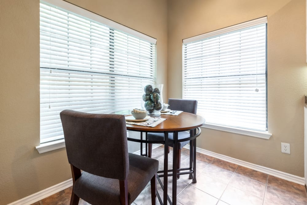 Dining corner of kitchen area with large windows at Marquis at Waterview in Richardson, Texas
