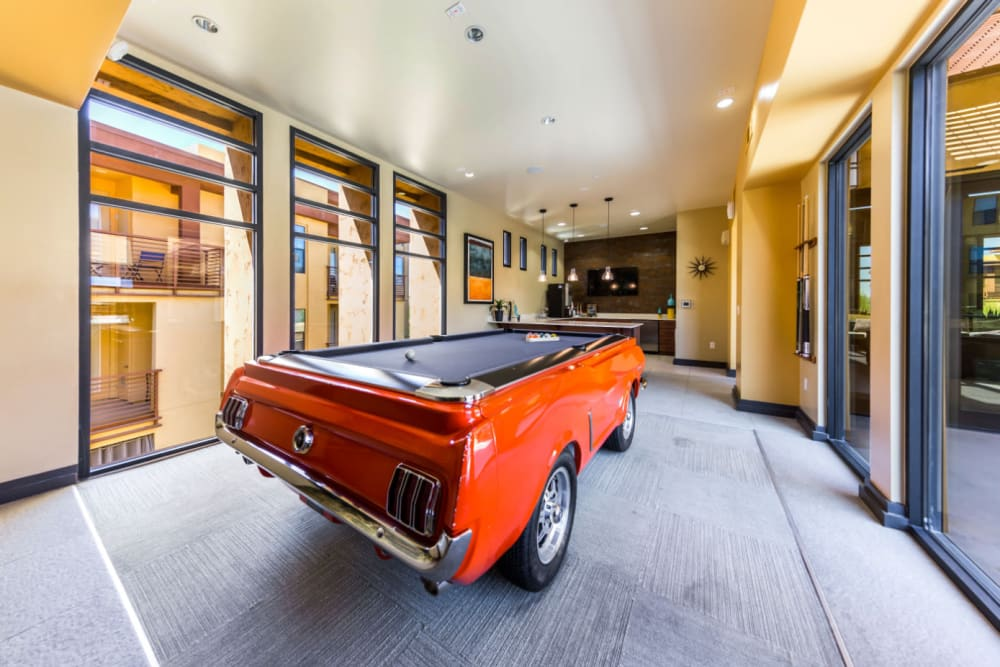 Converted Mustang pool table surrounded by windows at Marquis at Desert Ridge in Phoenix, Arizona
