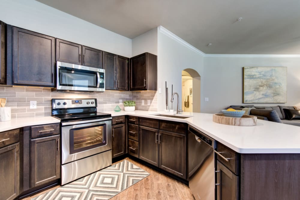 Kitchen with granite counters at Marquis at Cinco Ranch in Katy, Texas