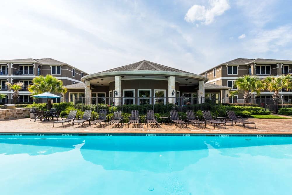 Sparkling pool facing clubhouse at Marquis at The Cascades in Tyler, Texas