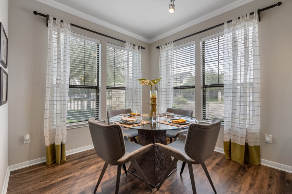 Bright dining area with large windows at Marquis at Sugar Land in Sugar Land, Texas