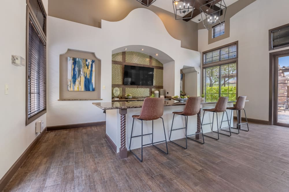 Community clubhouse kitchen and dining area at Marquis at Sonoran Preserve in Phoenix, Arizona