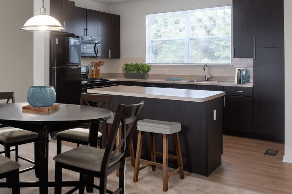 Kitchen with a kitchen island at The Grove Somerset in Somerset, New Jersey