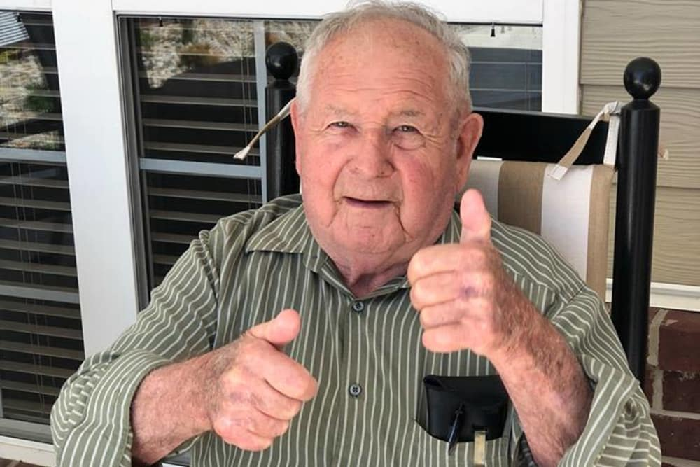 A resident giving two thumbs up at The Meadows of Delphos in Delphos, Ohio