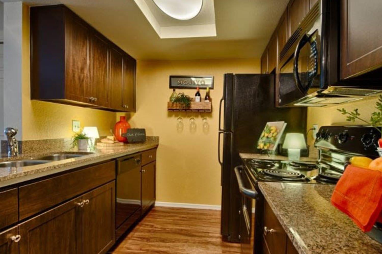 Enjoy a modern kitchen at Casa Santa Fe Apartments in Scottsdale, Arizona