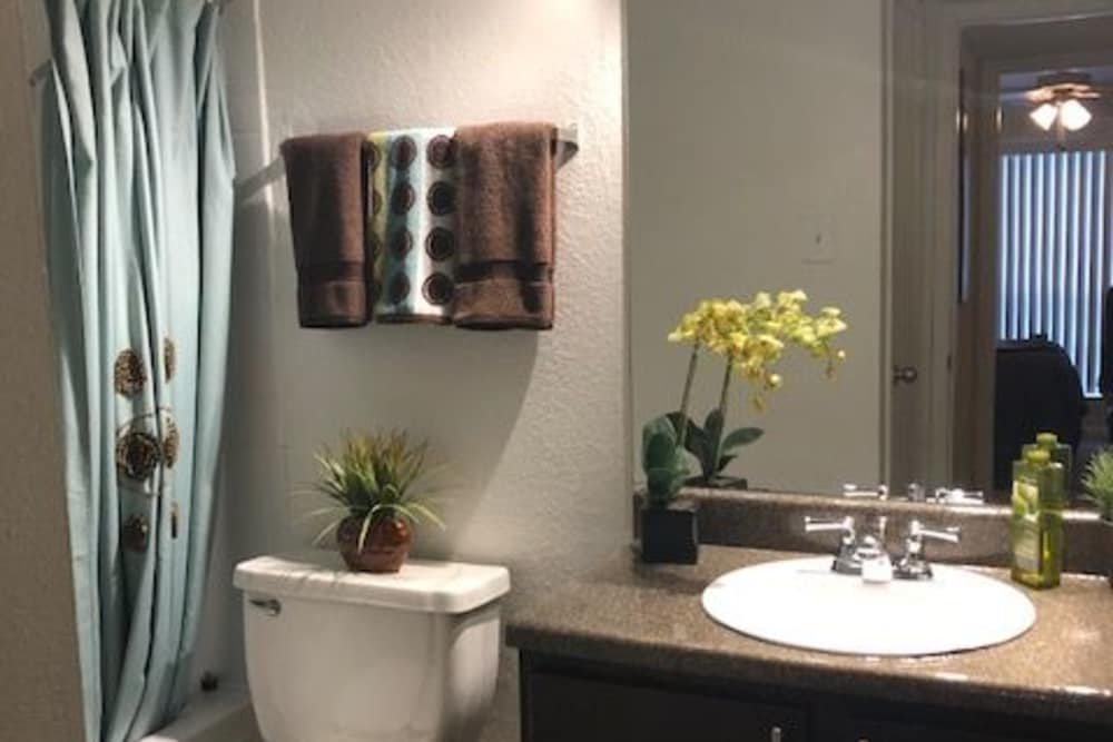 Bright bathroom at The Reserve at City Center North in Houston, Texas