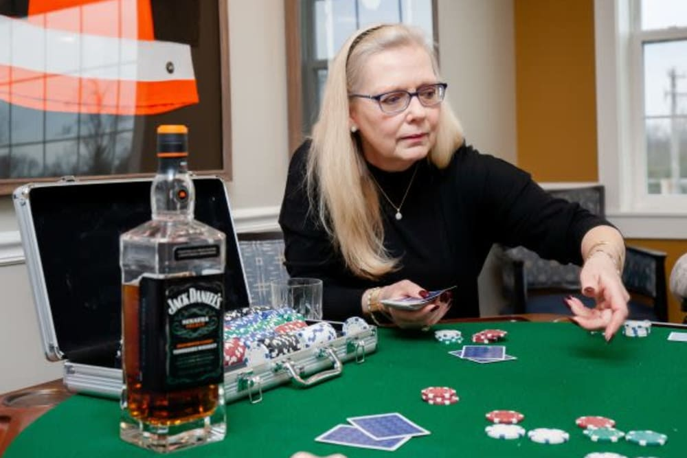 Resident playing cards at Mercer Hill at Doylestown in Doylestown, Pennsylvania