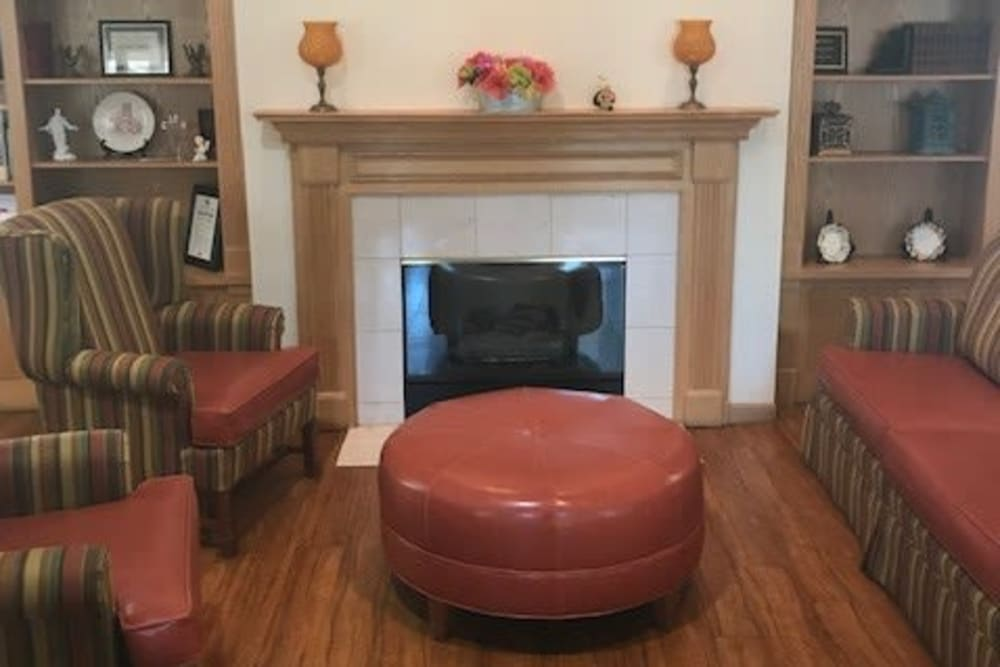 Comfortable sitting room with fireplace at Ramsey Woods in Cudahy, Wisconsin.