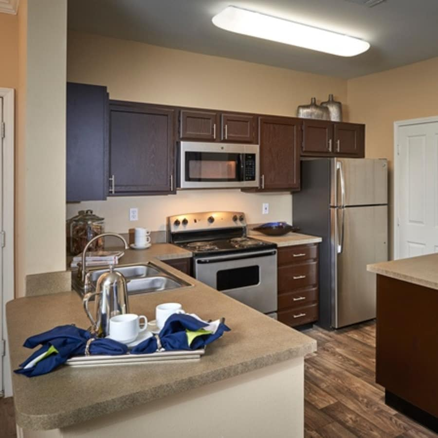 Legend Oaks Apartments brown renovated kitchen with stainless steel appliances