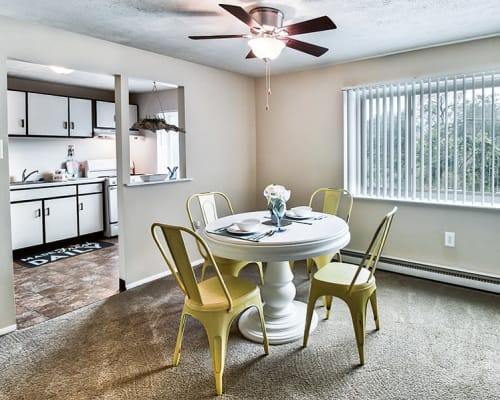 Dining area with a ceiling fan at Park Place of South Park in South Park, Pennsylvania