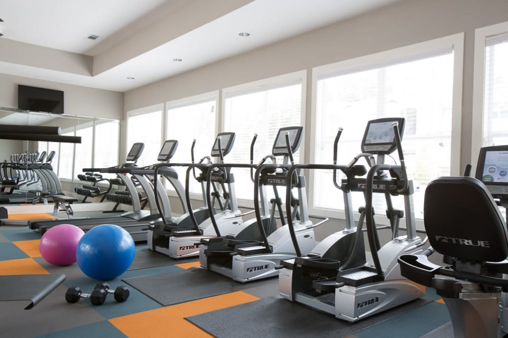 Fitness center with plenty of individual workout stations at Ansley Commons Apartment Homes in Ladson, South Carolina