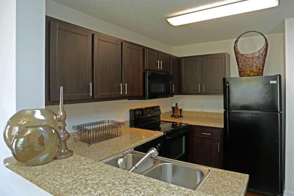 Well-lit kitchen at Savannah Place Apartments & Townhomes in Boca Raton, Florida
