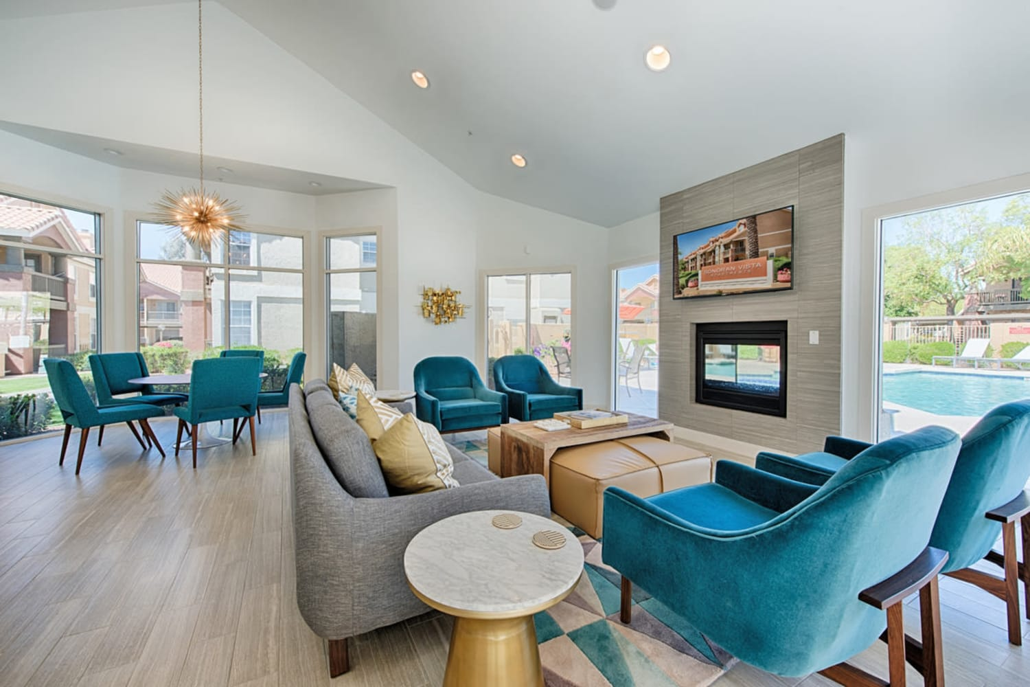 Sonoran Vista Apartments in Scottsdale, Arizona, offer a clubhouse with plenty of comfortable seating around the television