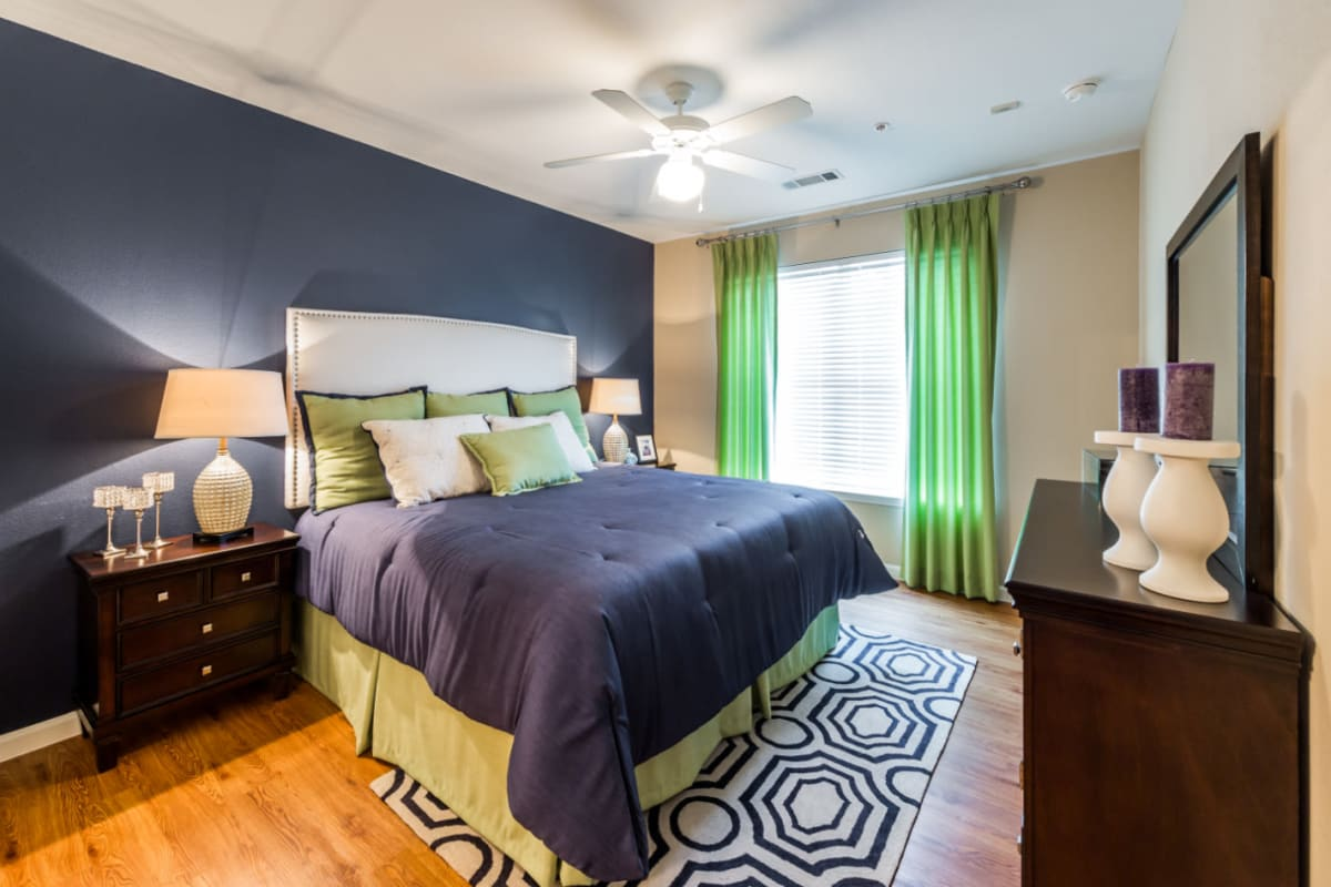 Bedroom with wood style flooring at Marquis at Canyon Ridge in Austin, Texas