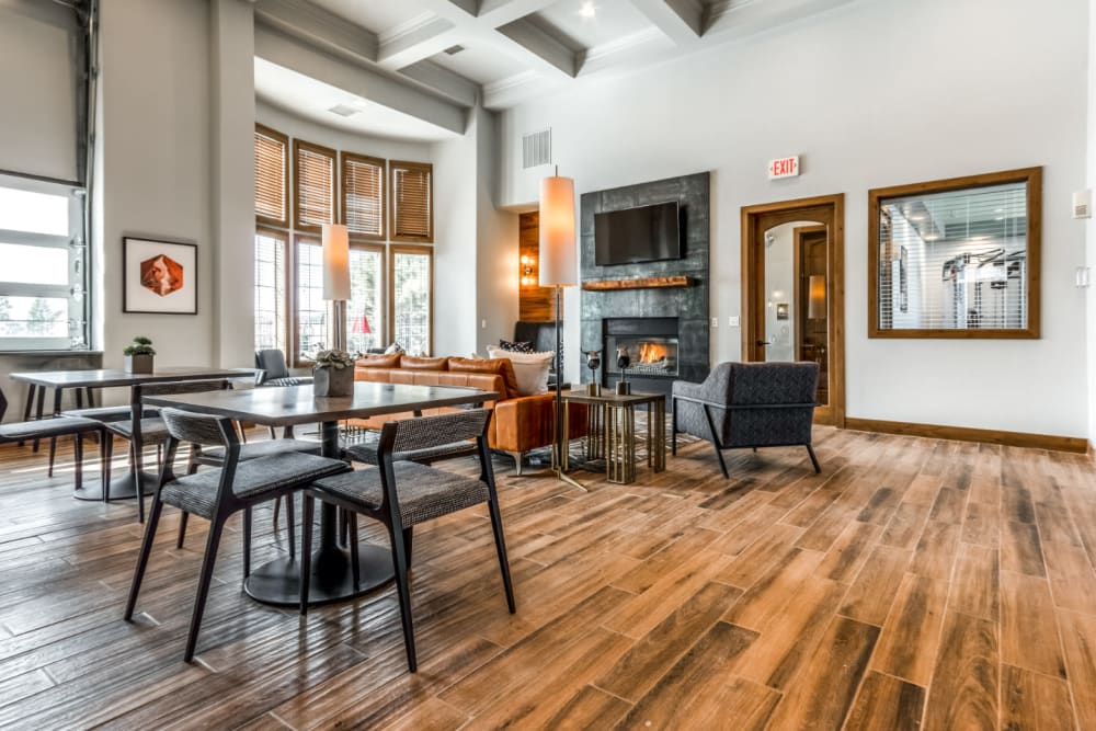 Large clubhouse with a fireplace and golf course views at  The Links at Plum Creek in Castle Rock, Colorado