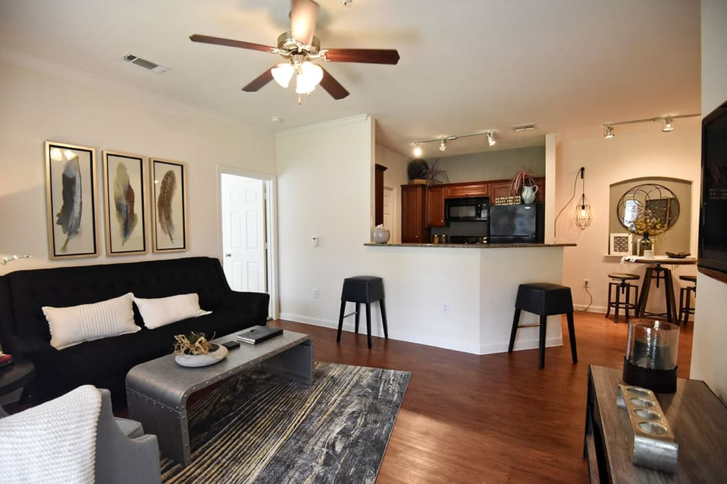 Apartment interior with hardwood flooring at Augusta Meadows in Tomball, Texas