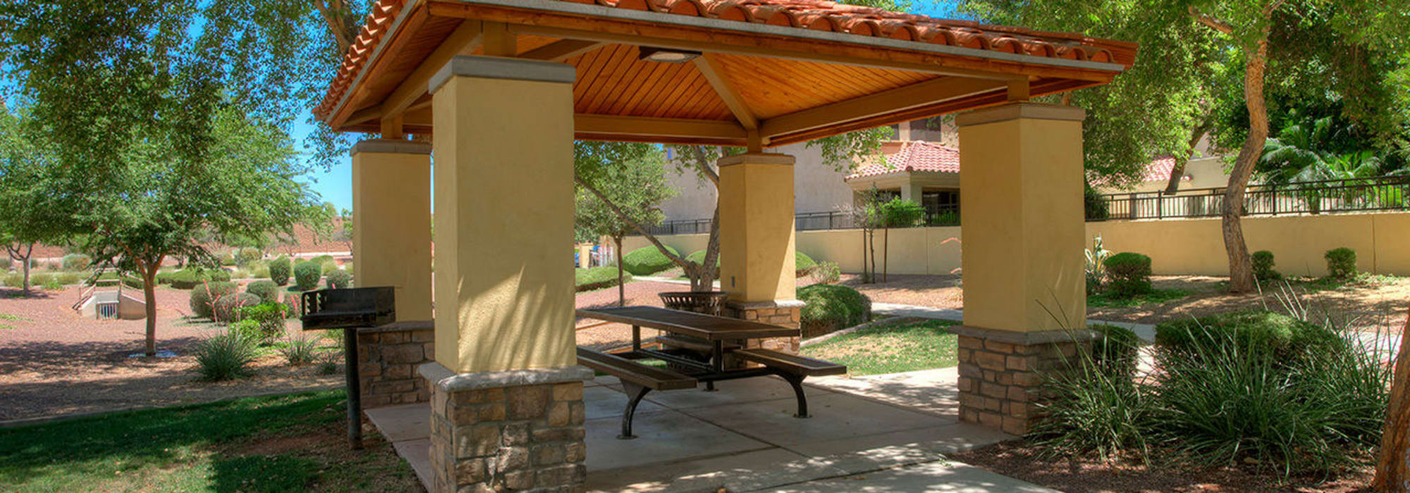 Covered table and outdoor grill at BB Living at Higley Park in Gilbert, Arizona