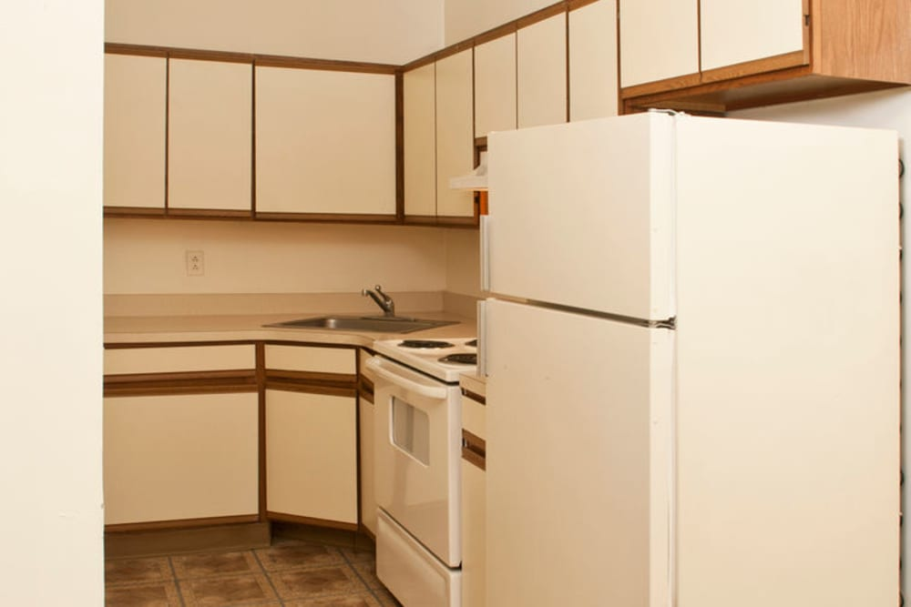White kitchen at Gregory Plaza in Passaic, New Jersey