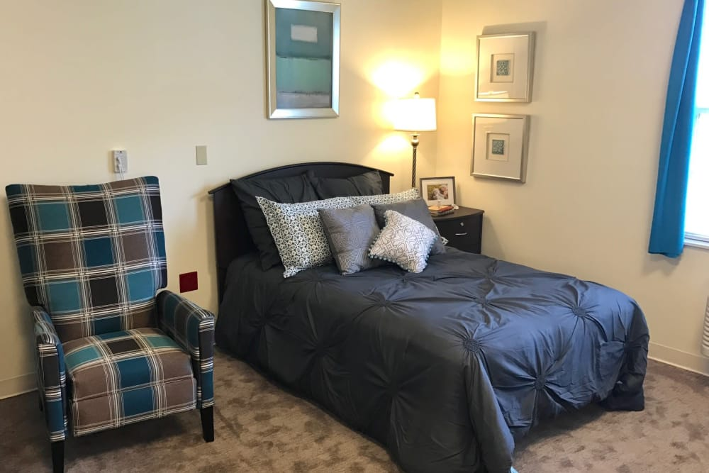 Bedroom with chair at Senior Living Facility in Fremont, Ohio