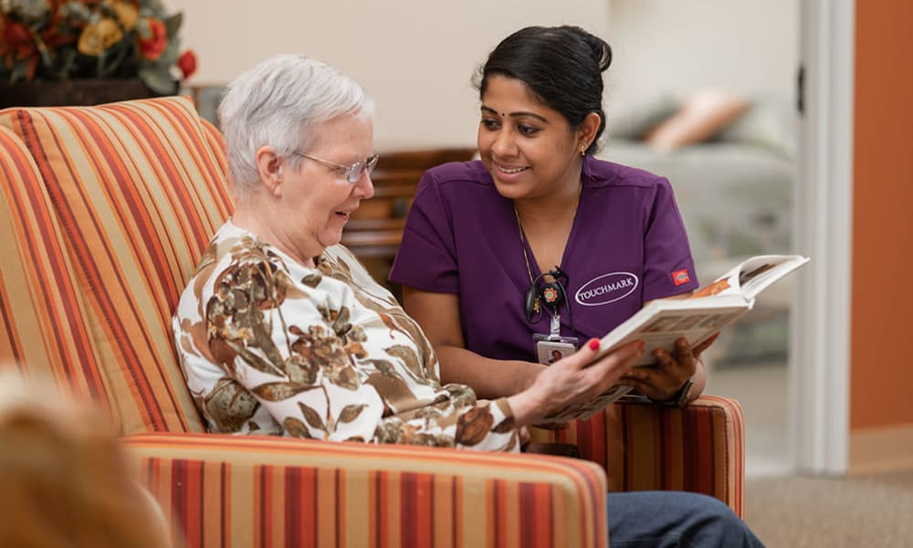 A resident and a team member at Touchmark at The Ranch in Prescott, Arizona chatting