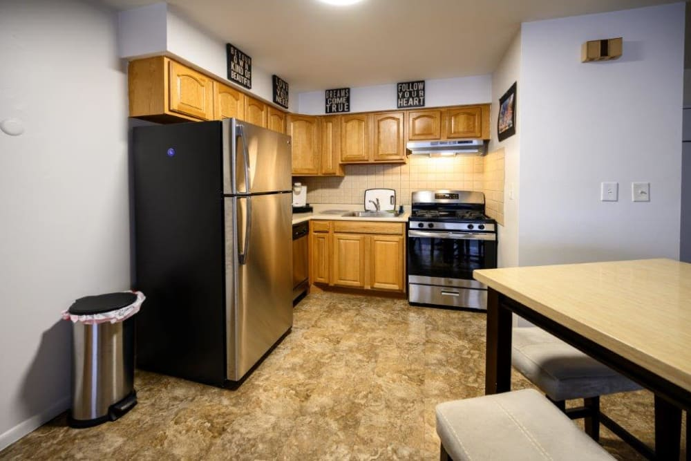 Kitchen with stainless steel appliances at The Central House in Ridgefield Park, New Jersey