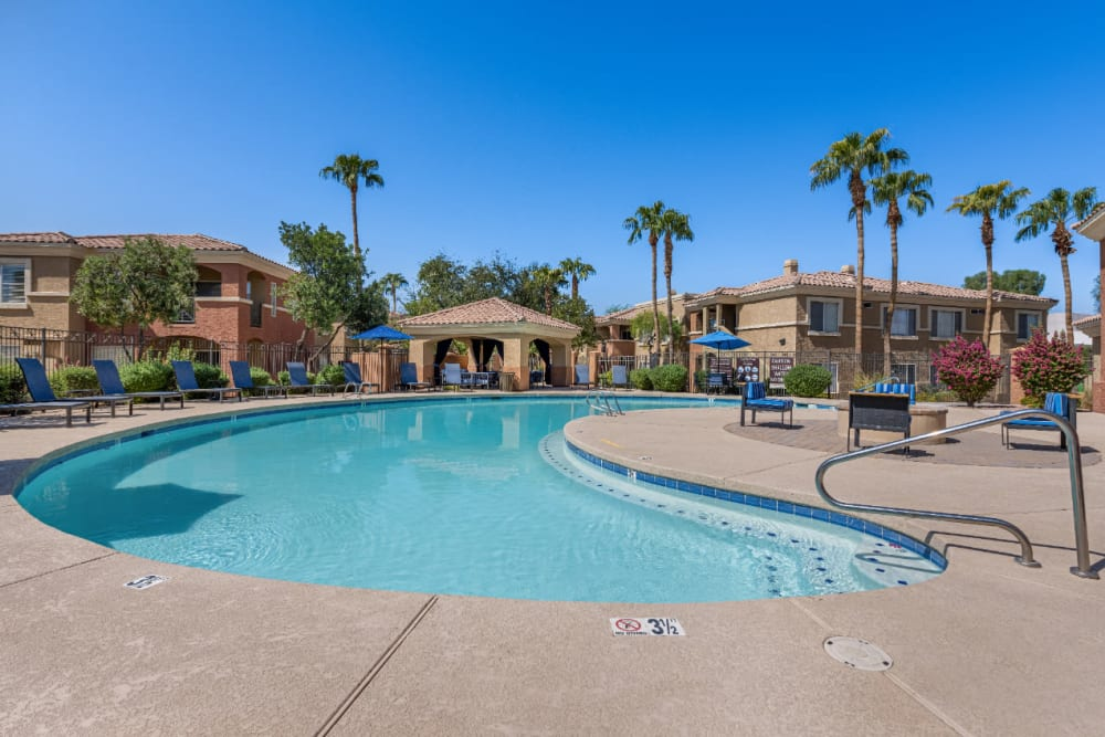 Swimming pool with gazebo and firepit area at Alante at the Islands in Chandler, Arizona