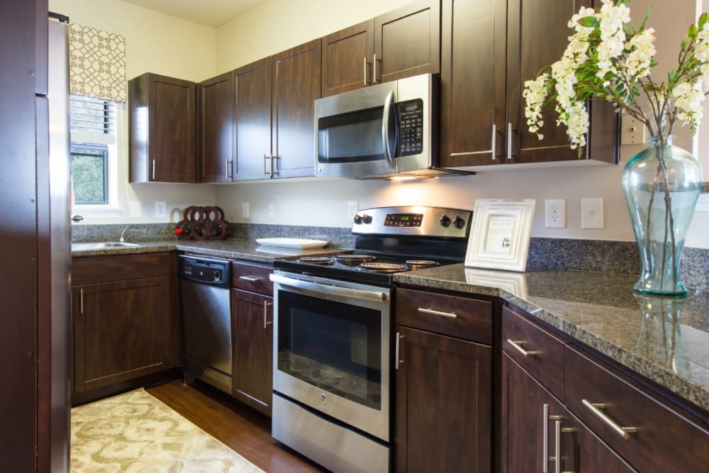 Kitchen with granite counters at Marquis at Treetops in Austin, Texas