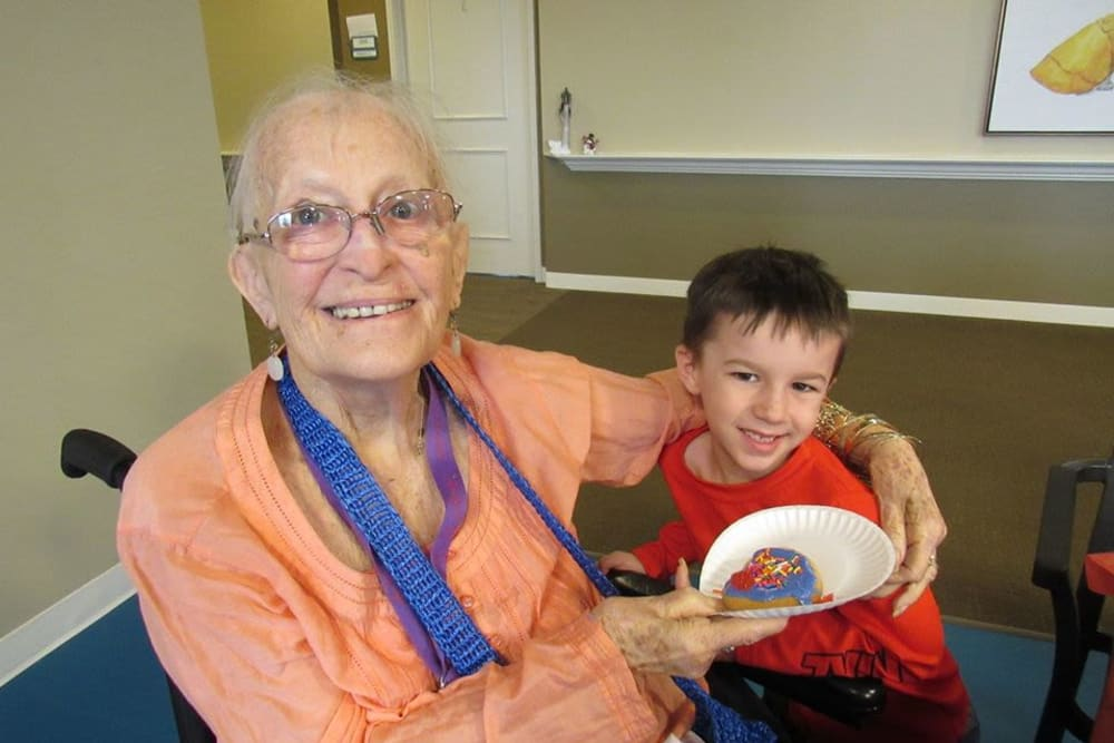 Resident and Grandchild at Aspired Living of Westmont