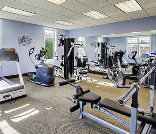 Fully-equipped fitness center at Knollwood Manor Apartments in Fairport, New York