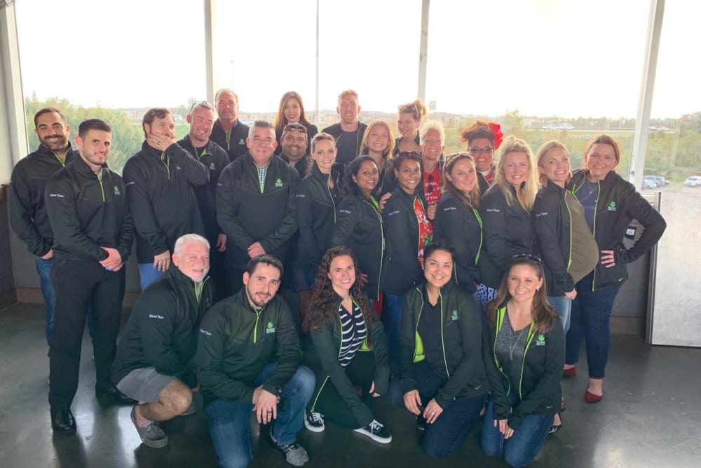 Group of staff in matching jackets at Inspired Living Ocoee in Ocoee, Florida.