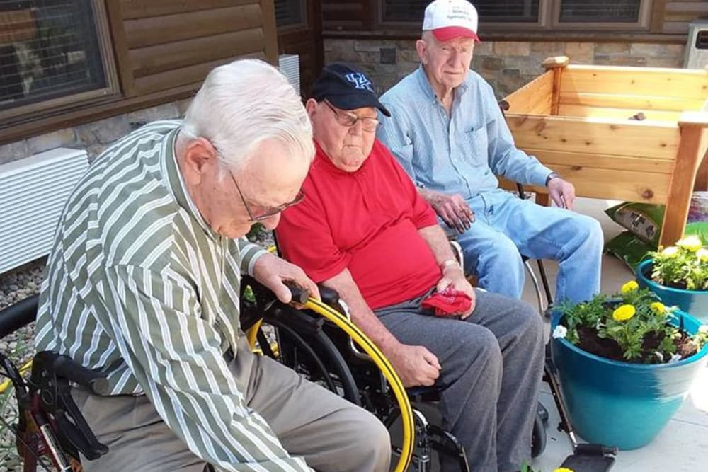 Three residents caring for potted plants at The Willows at Harrodsburg in Harrodsburg, Kentucky