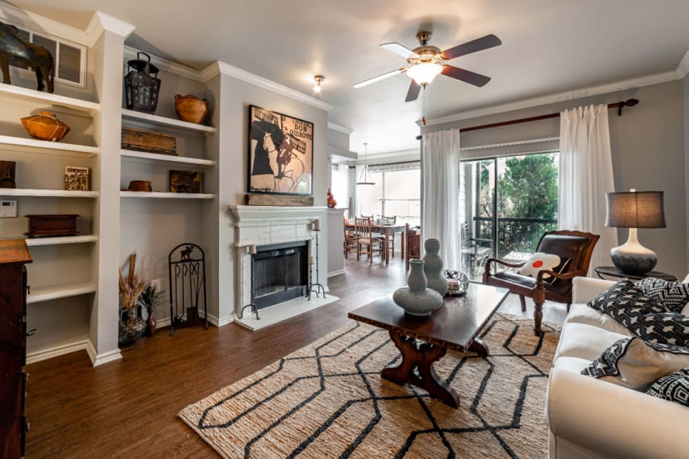 Spacious living area with wood style flooring at Marquis at Lantana in Flower Mound, Texas