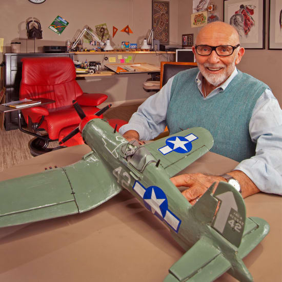 Resident with his airplane model at Madonna Gardens in Salinas, California