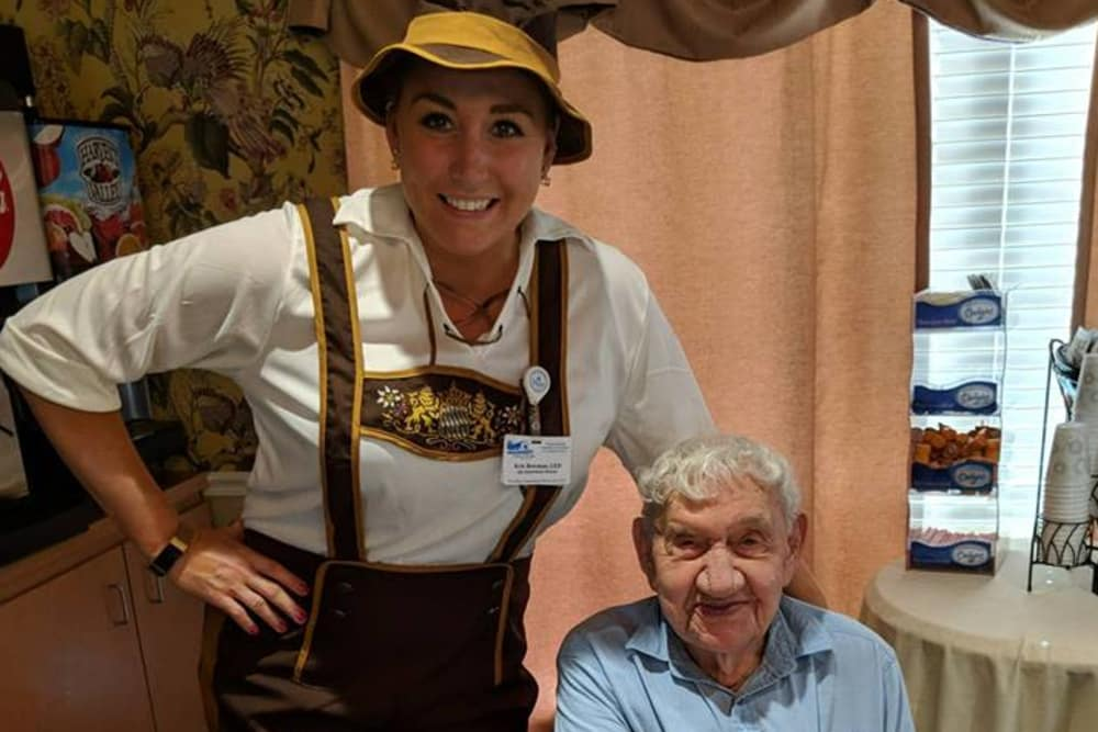 A resident and caretaker dressed in lederhosen at Covered Bridge Health Campus in Seymour, Indiana