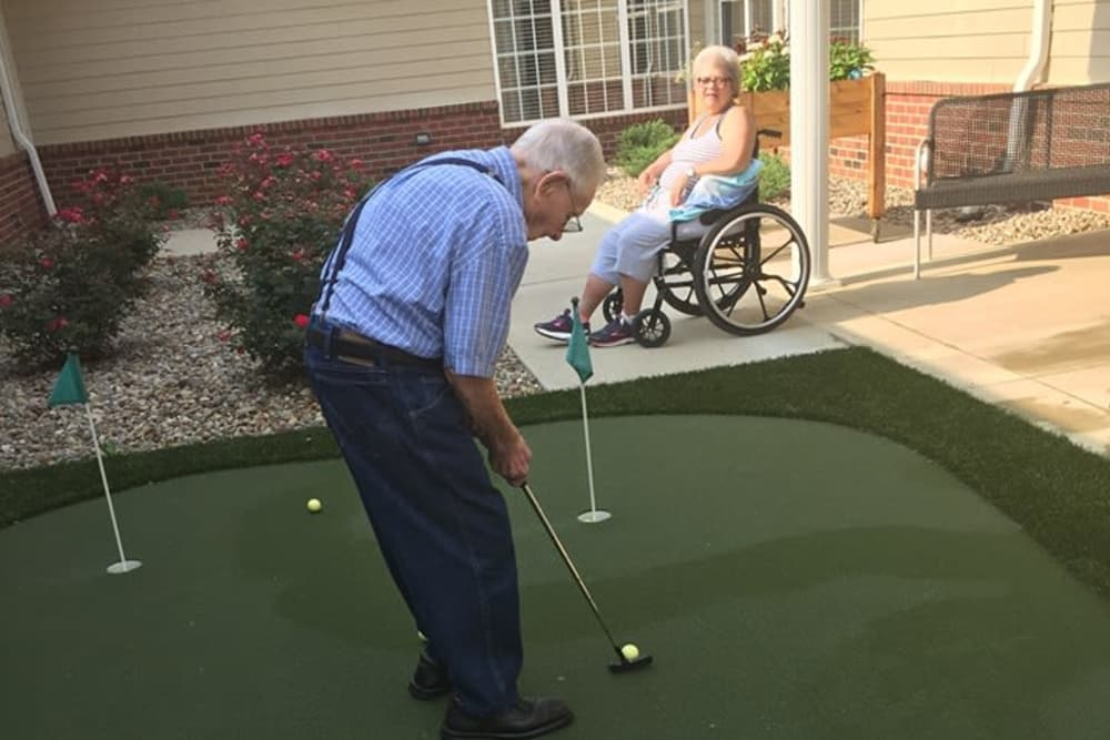 A gentleman relaxing with a round of mini golf at Harrison Springs Health Campus in Corydon, Indiana