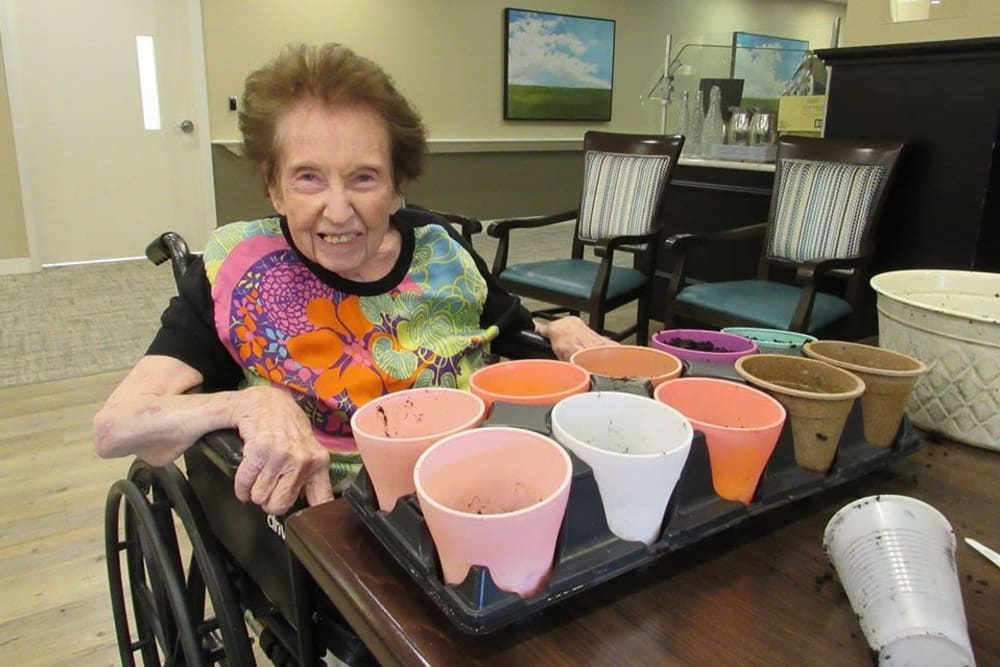 Resident potting plants at Aspired Living of Westmont