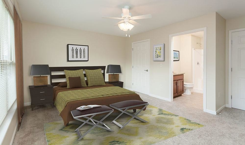 Enjoy a cozy bedroom at Saratoga Crossing apartments