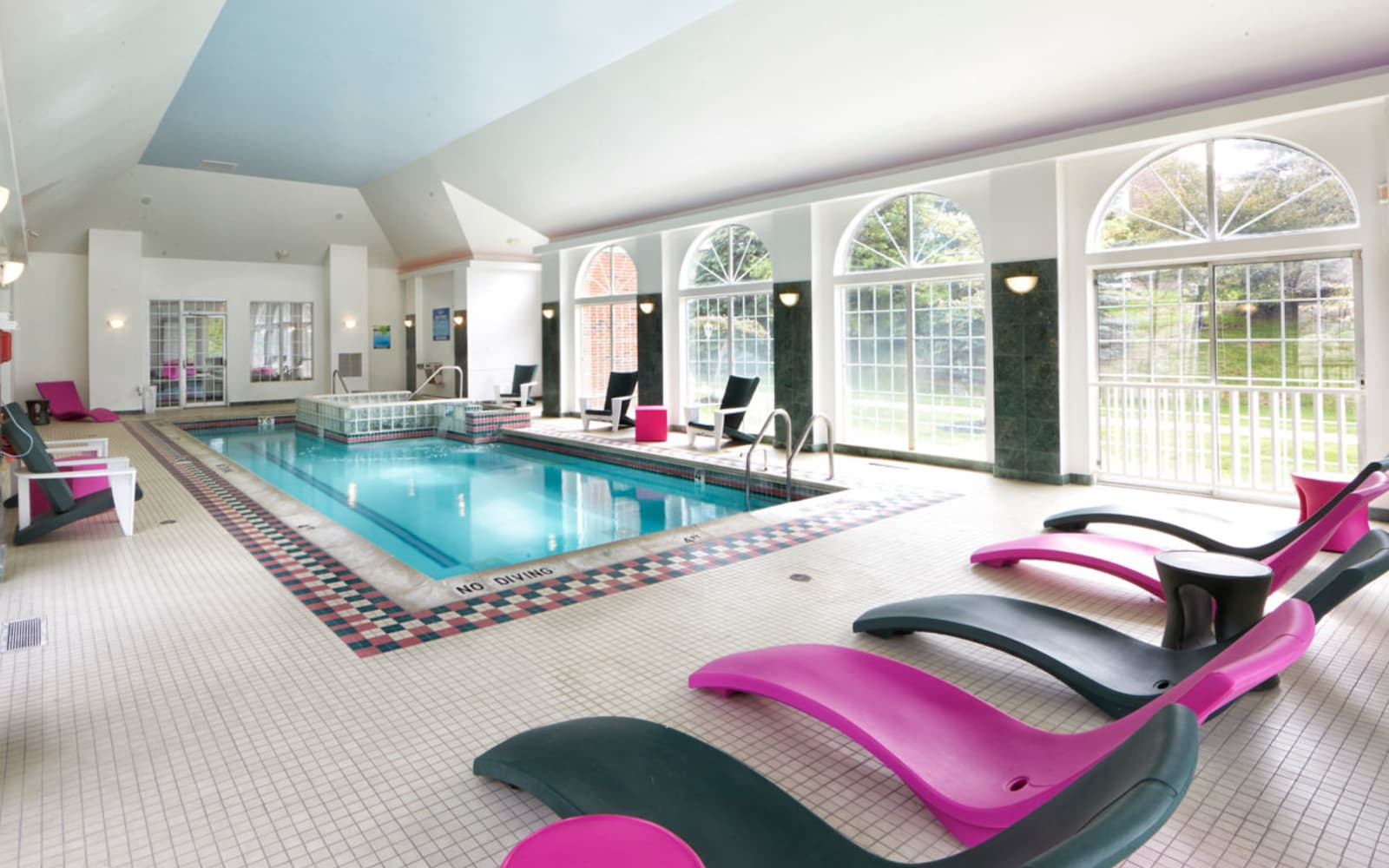 Indoor pool and poolside lounging at Citation Club in Farmington Hills, Michigan