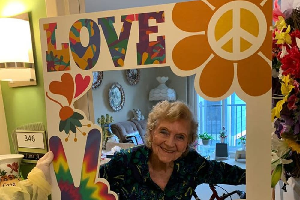 Resident with a peace sign at Azpira Place of Lake Zurich in Lake Zurich, Illinois