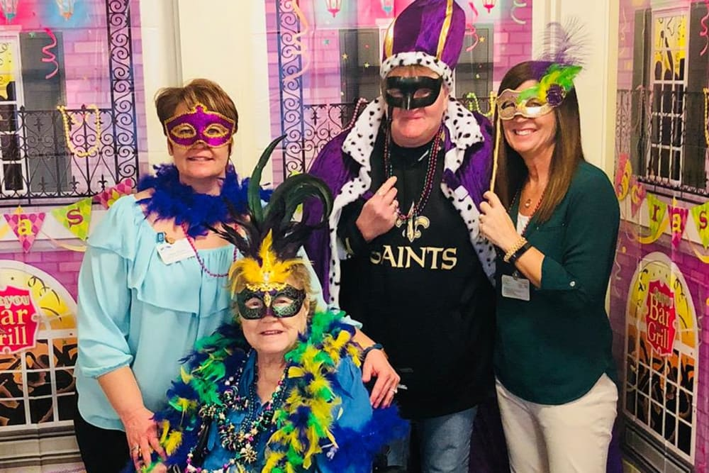 Female resident and staff celebrating Mardi Gras at River Pointe Health Campus in Evansville, Indiana